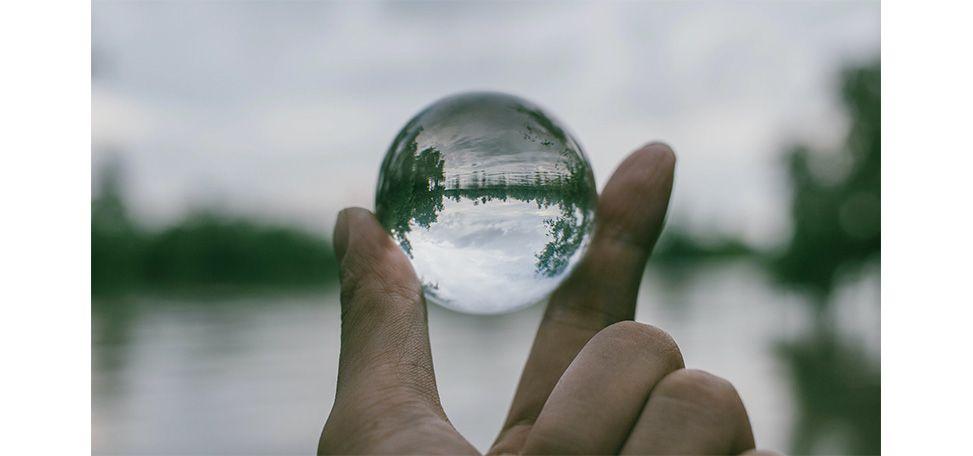 https://www.pexels.com/photo/close-up-photography-of-person-holding-crystal-ball-1071249/