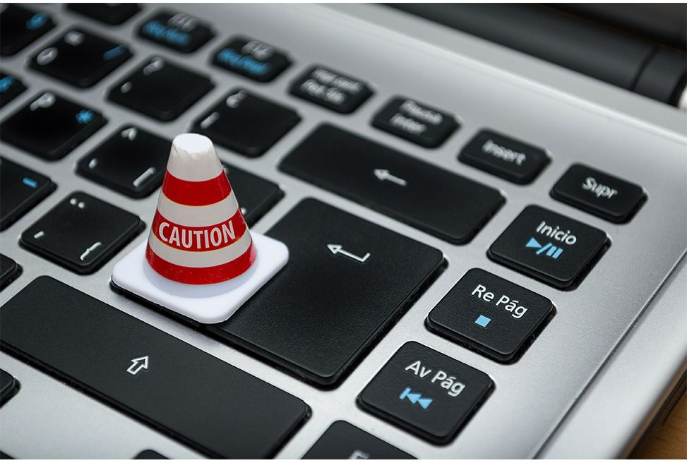 https://www.pexels.com/photo/white-caution-cone-on-keyboard-211151/
